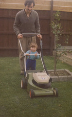 Cutting grass with Dad (mpozzobon) Tags: baby grass garden dad mark young lawnmover mpozzobon