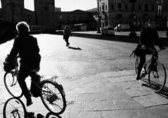 (motocchio) Tags: street morning people bw italy monochrome bike bicycle backlight italia bici piazza 2008 fo marzo saffi  explored piazzasaffi bnvitadistrada    filmfinishing