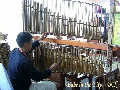Man playing angklung - view from back