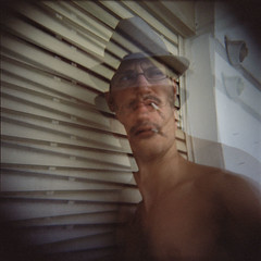 (A Whole New Way of) SMOKIN'! (elbud) Tags: portrait selfportrait eye film me hat self out gold glasses holga kodak cigarette shades smoking topless tungsten date expired vignetting vignette gpt outdated expire dated cfn overdate 100t overdated superbmasterpiece platinumheartaward