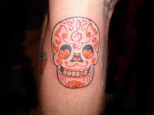 Lotus Tattoo · Breastfeeding tattoo · Sugar Skull Tattoo