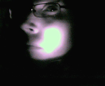 My face illuminated by the remote control #2