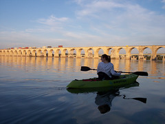 (kawkawpa) Tags: bridge blue yellow contrast train river kayak arch pennsylvania harrisburg kawkawpa susquehanna