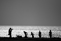([www.farhanahaque.com]) Tags: sea blackandwhite bw white playing black water silhouette glitter children photography football play jenny captured sandbar moment playful bayofbengal dublarchar gettyimagesbangladeshq2 farhanahaque gettyimagesbangladeshq3