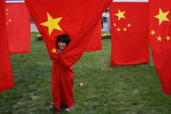 Wrapped in a nation. (DonDomingo) Tags: china proud canon star child flag nation chinese beijing    patriotism      canondigital dondomingo  dominicldin