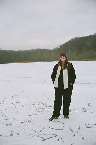 Sarah, standing on Lake Griffy
