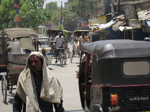 Bicycle rickshaws mix with tuk-tuks in Varanasi, India