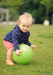 _JDS4768 (xstartxtodayx) Tags: portrait playing cute smiling ball fun happy suffolk spring nikon toddler zoey pretty dof sweet bokeh may 85mm naturallight longisland portjefferson greenball nikkor85mmf14d d700