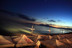 After sunset (vasi v) Tags: sunset sky beach clouds lights evening tents walk greece halkidiki