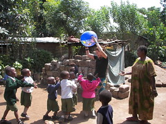 Playing Keep Away (spartan_puma) Tags: africa anna children tanzania teacher moshi faraja