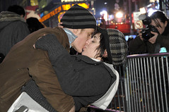 Love is in the air - New Years eve, New York 2008 (noamgalai) Tags: camera new nyc ny newyork love hat photography photo kiss kissing photographer year picture celebration photograph timessquare newyearseve 2008 allrightsreserved globalvillage sitenews   photomania  noamg noamgalai   globalcity invitedphotosonly gvadminshalloffame itsabeautifulgv wwwnoamgalaicom