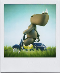 Sunday Ride (tubes.) Tags: cute film studio toy polaroid sx70 toys vespa vinyl scooter 600 rhino urbanvinyl limited ak47 titus anthropomorphize designertoys iwg affonso combatmodsquad tc078