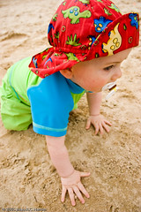 Baby boy on beach in red hat (BACHarbin) Tags: family boy usa baby male beach hat kid clothing sand toddler infant child hats va swimsuit youngster crawling louisa binky pacifier sunhat swimmingsuit nuk submittedtophotoshelter