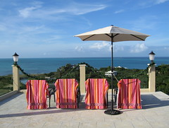 poolside view - Turks and Caicos (cosmo-girl) Tags: sunbathe chairsandumbrella stripedtowels beachtowels umbrella view seascape carribean patio vacation poolside towels blue carribeanlandscape zen clouds horizon sea ocean oceanview sunlounger sunbathing chairs ordinarythings geometric lines viewfrompatio archipelago aviewfromhere colors catch