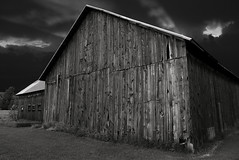 Storm's Brewin' (SheldonBranford (RichGreenePhotography.com)) Tags: wood sky blackandwhite bw storm monochrome clouds barn michigan greatlakes weathered highway31 challengeyouwinner richgreenephotography