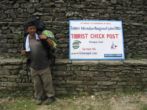 Nima Sherpa takes a break at the tourist checkpoint