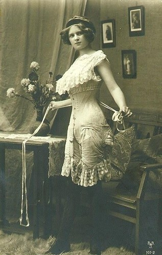 Beautiful young lady in her corset by Helen Stern.