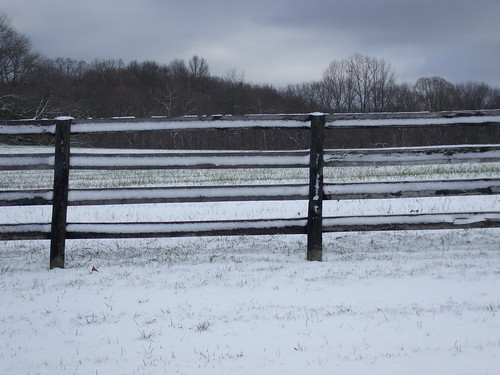 Snow blown on fence