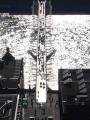 Millenium Bridge (ccr_358) Tags: uk greatbritain bridge light england people sun reflection london water sunshine silhouette thames architecture modern contrast reflections river dark gold golden shadows view unitedkingdom silhouettes millenium norman foster normanfoster blinding gb milleniumbridge riverthames londra granbretagna regnounito inghilterra londinium goldenlight rowingboat fromstpauls liquidgold upthedome ccr358
