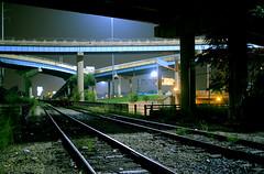 the urban jungle (gsgeorge) Tags: longexposure bridge autumn urban fall wet rain night train reflections highway midwest michigan detroit traintracks tracks bridges