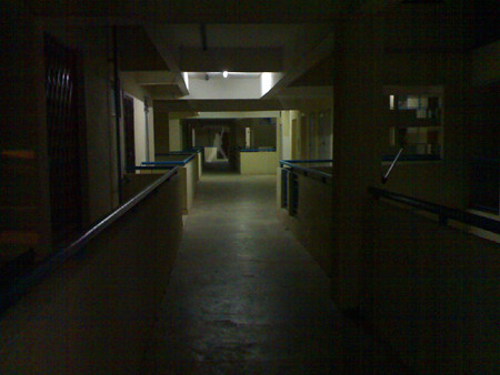 The light flickers on this night ala Creepy Corridor