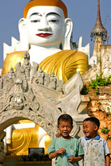 Big Buddha and little buddies-Burma (kinginexile) Tags: life kids portraits children asia buddha burma smiles buddhism myanmar inlelake shan itsong–mirrors–southeastasia