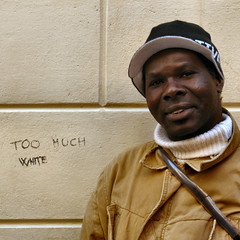 too much whites (Frizztext) Tags: africa portrait white black art square graffiti interestingness europe humorous politics rich poor humor explore barbara writer author slogan thirdworld littlestories frizztext platinumphoto picswithsoul 20080101