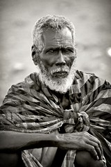 Ahmed, an old man in Khor Angar, Danakil (Eric Lafforgue) Tags: afardepression africa african africanculture beard blackandwhite confidence day djibouti eastafrica face frontview headandshoulders hornofafrica individuality lookingatcamera men mg5262 obok onemanonly oneperson people photography portrait realpeople riftvalley serious traditionalclothing traditionalculture traveldestination ubuk vertical etipia tribo       thiopien etiopa  ethiopi etiopia  etiopien etiopija  etiyopya    ethiopie