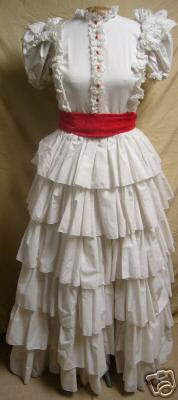 My dress as found, need to take off red buttons and re-work sash and add buckle.  Lace needed on ruffles and a few other spruce ups.