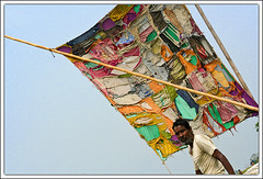 The Old Sail [..Daudkandi, Bangladesh..] (Catch the dream) Tags: life old sky colors rural river boat colorful bongo sail torn aged sailor patch bengal bangladesh struggle bangla stiches bengali bangladeshi bangali daudkandi catchthedream gettyimagesbangladeshq2