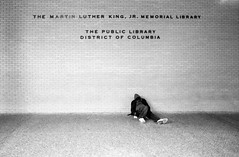 Martin Luther King Library (Alex Barth) Tags: street blackandwhite bw usa film washingtondc dc districtofcolumbia library homeless wideangle ishootfilm used dcist 20mm martinlutherking nikonfe2 inuse ilford400 martinlutherkingjrmemoriallibrary povertysucks diamondclassphotographer thepubliclibrarydistrictofcolumbia ilford400kodakd76 martinlutherkingpictures