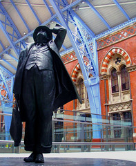 Sir John at St Pancras (Rich007) Tags: uk greatbritain blue roof england london station statue architecture bronze train europe cathedral eurostar unitedkingdom britain victorian railway terminal international poet gb canopy railways stpancras barlow jennings chunnel terminus channeltunnel poetlaureate betjeman 1868 saintpancras williamhenrybarlow johnbetjeman stpancrasinternational martinjennings thecathedralofrailways damnthosepigeons sirjohnbeterman