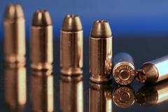macro reflection round bullet bullets ammo winchester brass lead ammunition nickle productshot blogworthy rounds 40caliber 40sw canoneos30d canonef10028 blacktalon everyonehasabigassignment everybullethassomeonesnameonit bulletwithyournameonit