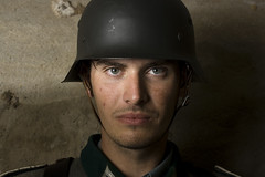 The Soldier (Jon McManus) Tags: guy wall closeup soldier model eyes german strobist germanuniform bnesa2 bnesa2malcolm