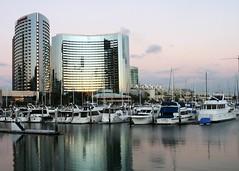 on the bay (terri_lg) Tags: water boats hotel bay downtown sandiego dusk embarcadero relfection terrigreen terrilg