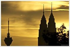 Golden (Dashuki Mohd) Tags: city sunset sky tower silhouette clouds lights evening bravo malaysia kualalumpur kl klcc twintower kltower petronastower abigfave canon400d canonef90300mmf4556usm diamondclassphotographer awe2020