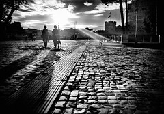 Walking on sunshine (.tyler. - Claudio Martella) Tags: street sky people bw sun white black castle sunshine backlight clouds walking angelo sant sanpietrini controluce claudiomartella