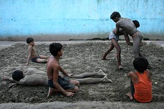 kushti  | Kolkata (arnabchat) Tags: street blue orange india boys composition canon river nice wrestling traditional clay favs kolkata bengal calcutta howrahbridge hooghly ghaat kusti 400d arnabchat arnabchatterjee