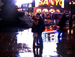 Love is all around me... (ro_nya) Tags: light urban london love rain kiss couple neon candid piccadillycircus explore liebe regen inlove kuss deutschetelekom ronya ronyagalkacom invitedby