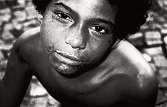 If you have food in the refrigerator, clothes on your back, a roof overhead and a place to sleep.......... (carf) Tags: poverty christmas xmas light boy brazil bw boys girl brasil sepia kids children hope star blackwhite kid community education support child hummingbird forsakenpeople esperana social impoverished underprivileged altruism educational gaze campaign streetkids streetchildren beijaflor development investment prevention sponsors eduardo hummingbirdxmas donations sponsorship sponsoring contribute reachingforastar girlsatrisk