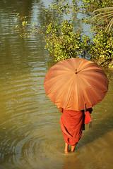 Monk in the river - Mrauk U - Myanmar (PascalBo) Tags: red people man umbrella river rouge outdoors nikon asia southeastasia d70 burma monk buddhism rivière parasol myanmar asie homme parapluie bouddhisme birmanie mrauku moine ombrelle rakhinestate myohaung 123faves asiedusudest lpruck pascalboegli