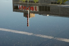 Seaport Museum (RobertFrancis) Tags: reflection tag3 taggedout puddle outdoors nikon parkinglot tag2 day tag1 d70 pavement pennslanding seaportmuseum