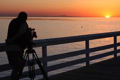 sunrisecameraman (smihan13) Tags: ocean california people orange color beauty silhouette sunrise pier with crane boom equipment nothing jib naranja cameraman filmcrew rhymes blorenge rhymeswithorange netneutrality matters2me