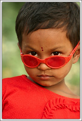 It's all about Attitude [..Chuadanga, Bangladesh..] (Catch the dream) Tags: red portrait look festival youth rural children eyes child bright bongo attitude spectacles bengal bangladesh bangla bengali bangladeshi bangali chuadanga catchthedream gettyimagesbangladeshq2