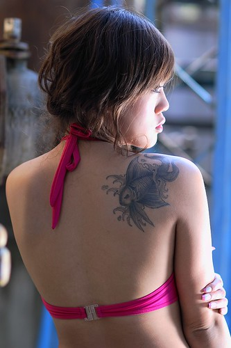 Design fishes out koi on hinder up girl