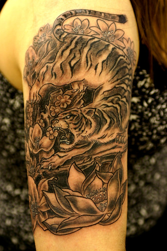 Tiger Tattoo. A full color Tiger and background scene across the chest by