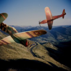 air attack ! (rougerouge) Tags: road plane toy flying air gliders holgadigital filmmanip