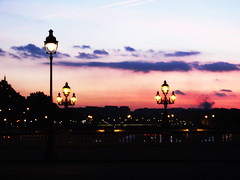 Pink Sky over Paris ({JO}) Tags: bridge sunset holiday paris lights lanterns pont lamps pinksky pontalexandre abigfave