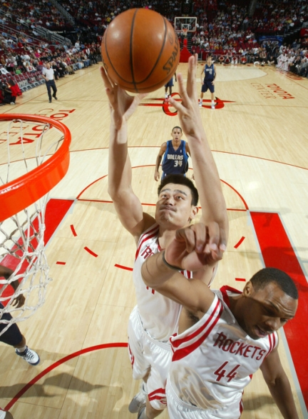 Yao Ming goes up for a shot against the Dallas Mavericks Wednesday night.  Yao's numbers were phenomenal: 30 points, 15 rebounds, 6 blocks.  But the Rockets blew a big lead and lost another one in the clutch, this time to Dallas.