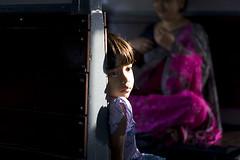 First Ray of Sun (Sandip Debnath) Tags: road trip travel pink portrait woman sunlight color eye girl face train children eyes women child expression rail journey commuter railways darjeeling bengali sandip westbengal younggirls sandipdebnath lptrain